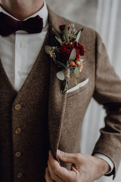 a-chic-brown-tweed-three-piece-suit-a-whiet-shirt-a-burgundy-velvet-bow-tie-and-a-floral-boutonniere.jpg