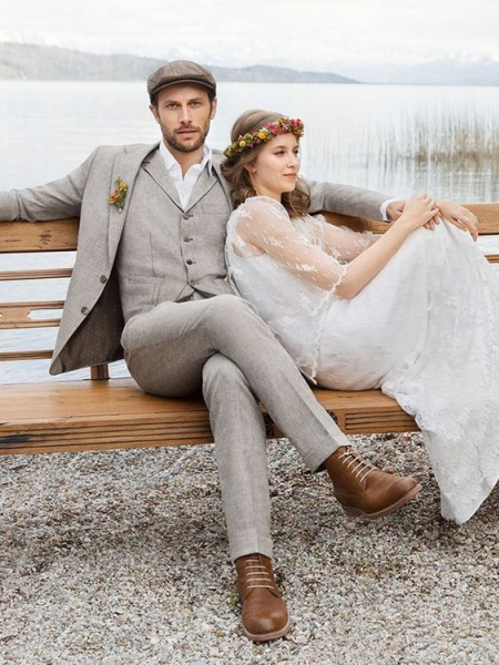 a-grey-three-piece-suit-a-white-shirt-a-brown-cap-and-brown-shoes-for-a-vintage-inspired-grooms-look.jpg